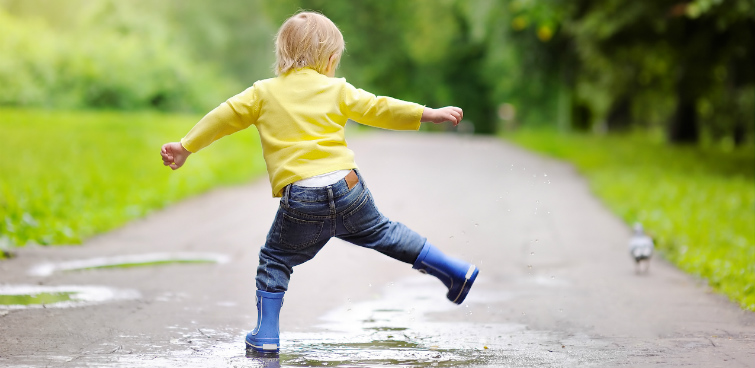 Boy in puddles